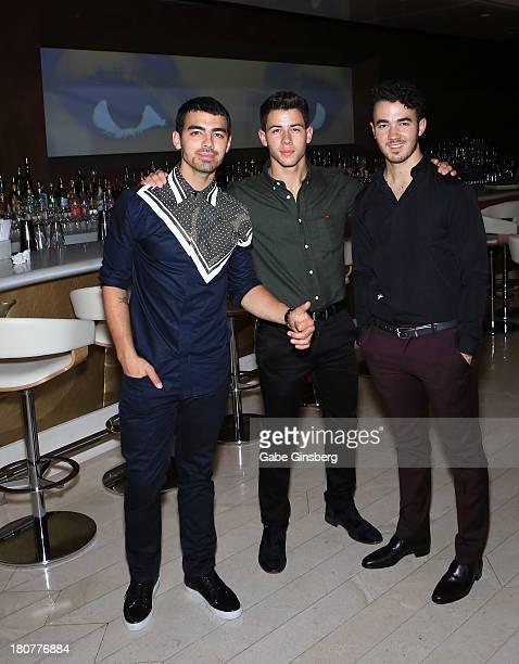 Recording artists Joe Jonas Nick Jonas and Kevin Jonas celebrate Nick Jonas 21st birthday at Andrea's at Encore Las Vegas on September 14 2013 in Las...