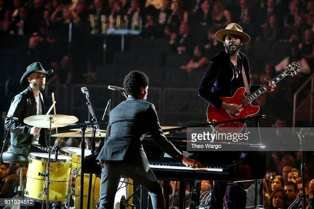 Recording artists Joe Saylor Jon Batiste and Gary Clark Jr perform onstage during the 60th Annual GRAMMY Awards at Madison Square Garden on January...