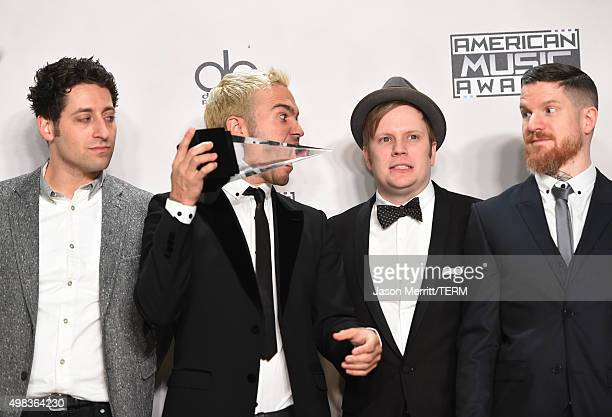 Recording artists Joe Trohman Pete Wentz Patrick Stump and Andy Hurley of Fall Out Boy winners of Favorite Alternative Artist pose in the press room...