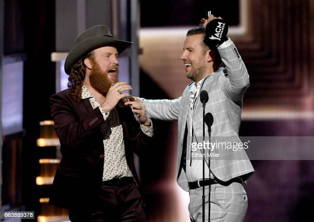 Recording artists John Osborne and TJ Osborne of music group Brothers Osborne accept the Vocal Duo of the Year award onstage during the 52nd Academy...