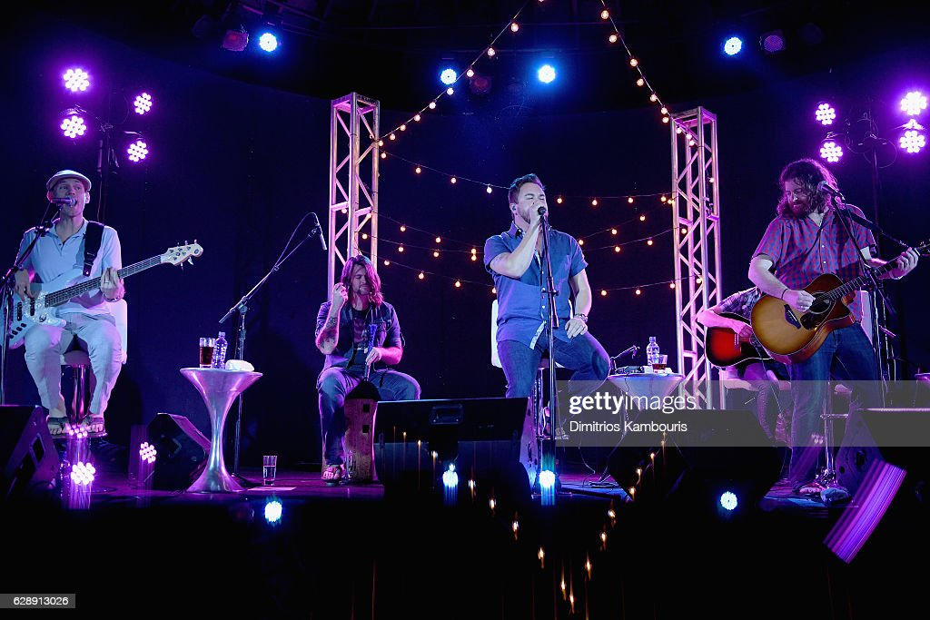 Recording artists Jon Jones, Chris Thompson, Mike Eli, and James Young of Eli Young Band perform onstage during CMT Story Behind The Songs LIV + Weekend at Sandals Royal Bahamian Spa Resort & Offshore Island - Day 2 at Sandals Royal Bahamian on December 9, 2016 in Nassau, Bahamas.