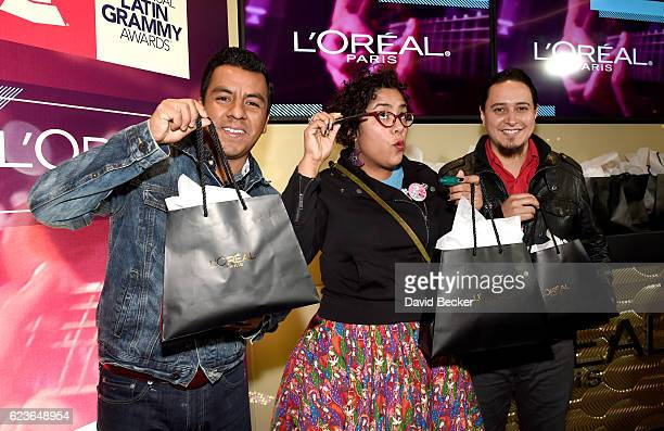 Recording artists Jose Carlos Marisol Hernandez and Alex Bendana of La Santa Cecilia attend the gift lounge during the 17th annual Latin Grammy...