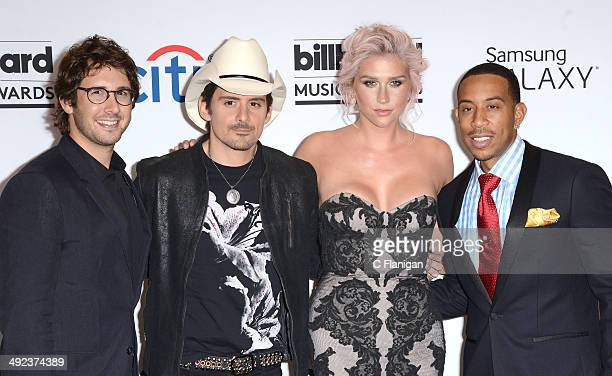 a8e70c6aaed4e Recording artists Josh Groban Brad Paisley Kesha and Ludacris pose backstage  during the 2014 Billboard Music
