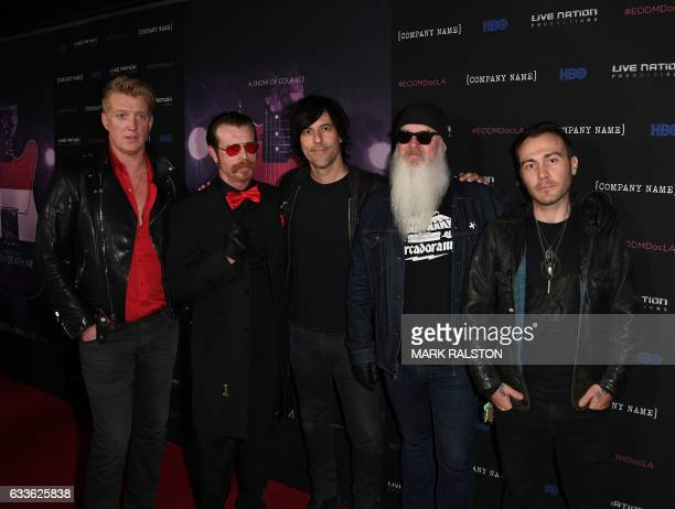 Recording artists Josh Homme Jesse Hughes Matt McJunkins Dave catching and Jorma Vik attend the premiere of 'Eagles of Death Metal' at the Avalon...