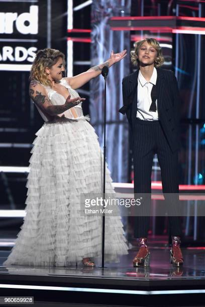 Recording artists Julia Michaels and Grace Vanderwaal speak onstage during the 2018 Billboard Music Awards at MGM Grand Garden Arena on May 20, 2018...