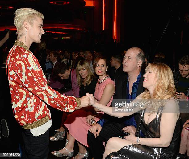 Recording artists Justin Bieber and Courtney Love in Saint Laurent by Hedi Slimane attend Saint Laurent at the Palladium on February 10 2016 in Los...