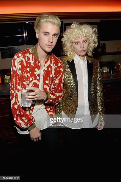 Recording artists Justin Bieber in Saint Laurent by Hedi Slimane and Lady Gaga in Saint Laurent by Hedi Slimane attend Saint Laurent at the Palladium...