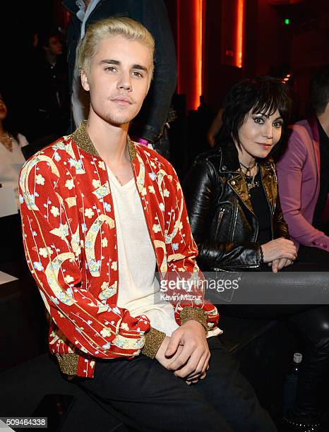 Recording artists Justin Bieber in Saint Laurent by Hedi Slimane and Joan Jett attend Saint Laurent at the Palladium on February 10 2016 in Los...