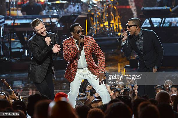 Recording artists Justin Timberlake Charlie Wilson and Pharrell Williams perform onstage during the 2013 BET Awards at Nokia Theatre LA Live on June...