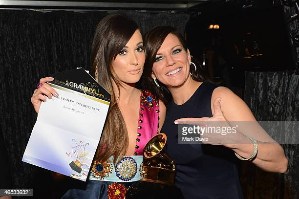 Recording artists Kacey Musgraves and Martina McBride attend the 56th GRAMMY Awards at Staples Center on January 26 2014 in Los Angeles California