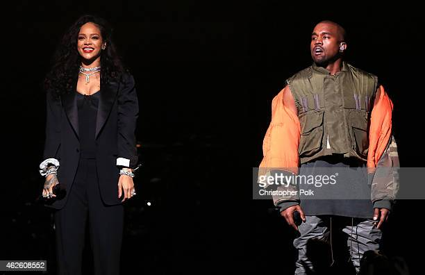 Recording artists Kanye West and Rihanna perform onstage during DirecTV Super Saturday Night hosted by Mark Cuban's AXS TV and Pro Football Hall of...