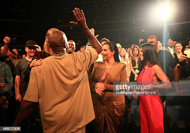 Recording artists Kanye West Taylor Swift and TV personality Kim Kardashian attend the 2015 MTV Video Music Awards at Microsoft Theater on August 30...