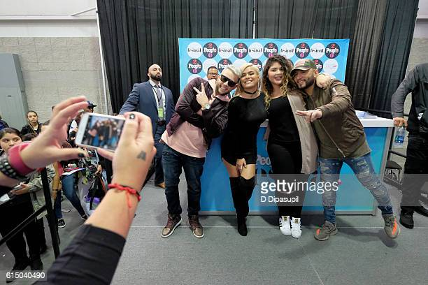 Recording artists Karol G and Alex Sensation pose backstage during the 5th Annual Festival PEOPLE En Espanol Day 2 at the Jacob Javitz Center on...