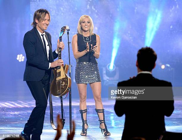 Recording artists Keith Urban and Carrie Underwood perform onstage during FOX's 'American Idol' Finale For The Farewell Season at Dolby Theatre on...