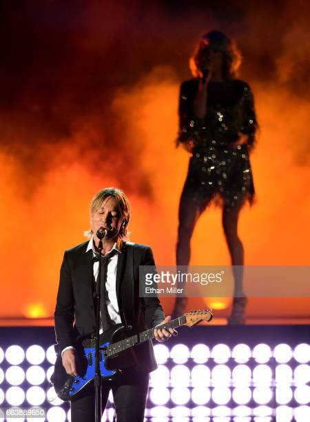 Recording artists Keith Urban and Carrie Underwood perform onstage during the 52nd Academy of Country Music Awards at TMobile Arena on April 2 2017...