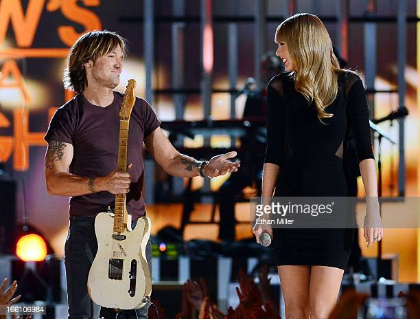 Recording artists Keith Urban and Taylor Swift perform onstage during Tim McGraw's Superstar Summer Night presented by the Academy of Country Music...