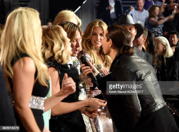 Recording artists Keith Urban Faith Hill and music group Backstreet Boys member Kevin Richardson attend the 52nd Academy of Country Music Awards at...