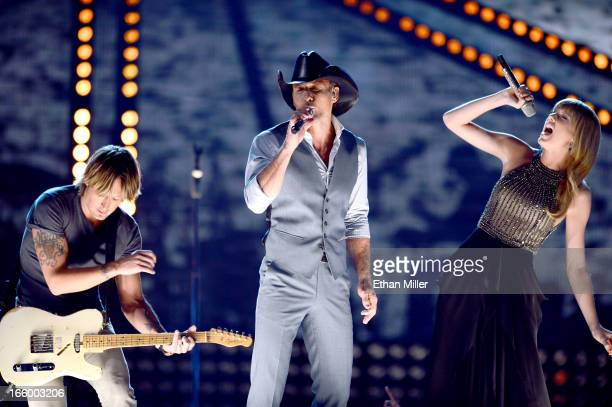 Recording artists Keith Urban Tim McGraw and Taylor Swift perform onstage during the 48th Annual Academy of Country Music Awards at the MGM Grand...