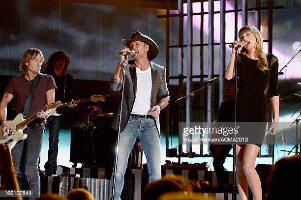 Recording artists Keith Urban Tim McGraw and Taylor Swift perform onstage during Tim McGraw's Superstar Summer Night presented by the Academy of...