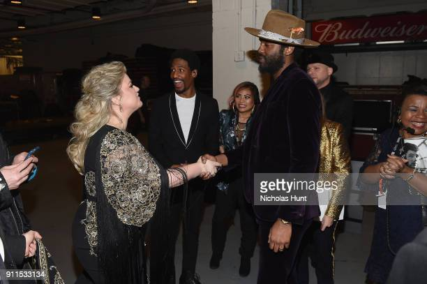 Recording artists Kelly Clarkson Gary Clark Jr and Jon Batiste pose backstage at the 60th Annual GRAMMY Awards at Madison Square Garden on January 28...