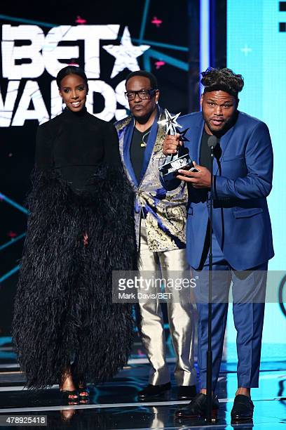 Recording artists Kelly Rowland Charlie Wilson and cohost Anthony Anderson speak onstage during the 2015 BET Awards at the Microsoft Theater on June...