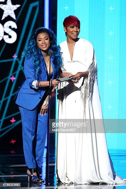 Recording artists Keyshia Cole and Monica speak onstage during the 2015 BET Awards at the Microsoft Theater on June 28 2015 in Los Angeles California