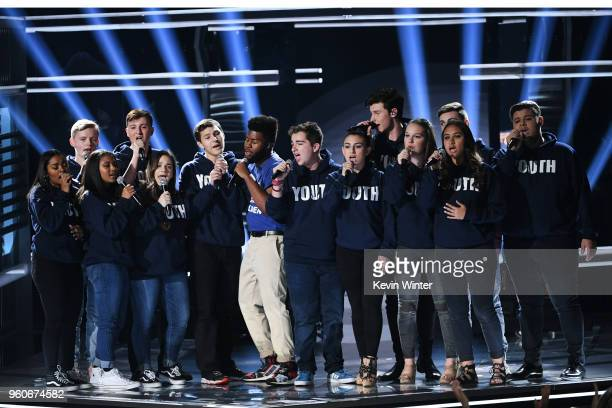 Recording artists Khalid and Shawn Mendes perform with members of the Marjory Stoneman Douglas High School Show Choir onstage during the 2018...