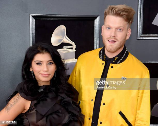 Recording artists Kirstin Maldonado and Scott Hoying of musical group Pentatonix attends the 60th Annual GRAMMY Awards at Madison Square Garden on...