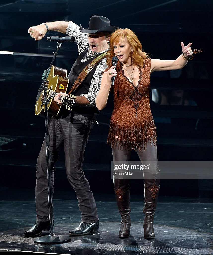 Recording artists Kix Brooks (L) and Reba McEntire perform during the opening weekend of their residency 'Reba, Brooks & Dunn: Together in Vegas' with Ronnie Dunn (not pictured) at The Colosseum at Caesars Palace on June 19, 2015 in Las Vegas, Nevada.