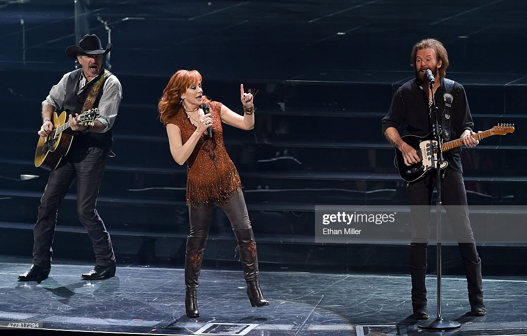 Recording artists Kix Brooks, Reba McEntire and Ronnie Dunn perform during the opening weekend of their residency 'Reba, Brooks & Dunn: Together in Vegas' at The Colosseum at Caesars Palace on June 19, 2015 in Las Vegas, Nevada.