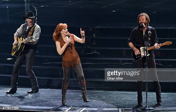 Recording artists Kix Brooks Reba McEntire and Ronnie Dunn perform during the opening weekend of their residency Reba Brooks Dunn Together in Vegas...