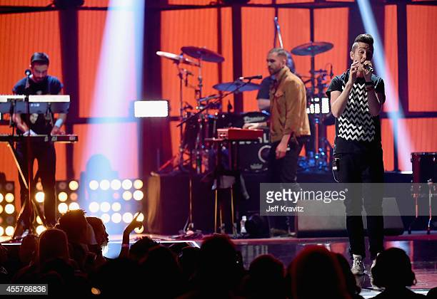 Recording artists Kyle J Simmons William Farquarson and Dan Smith of the band Bastille perform onstage during the 2014 iHeartRadio Music Festival at...