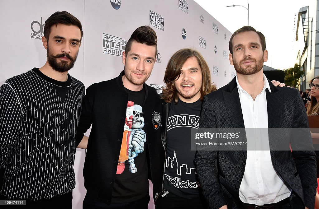 Recording artists Kyle Simmons, Dan Smith, Chris 'Woody' Wood, and Will Farquarson of Bastille attend the 2014 American Music Awards at Nokia Theatre L.A. Live on November 23, 2014 in Los Angeles, California.