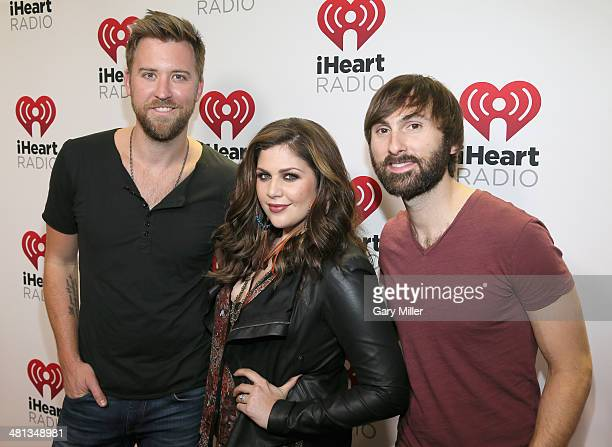 Recording artists Lady Antebellum's Charles Kelley Hillary Scott and Dave Haywood attend iHeartRadio Country Festival in Austin at the Frank Erwin...