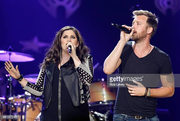 Recording artists Lady Antebellum's Hillary Scott and Charles Kelley perform onstage during iHeartRadio Country Festival in Austin at the Frank Erwin...