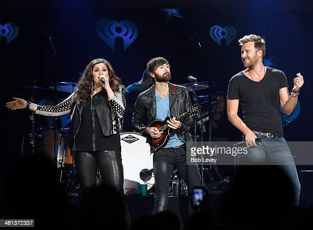 Recording artists Lady Antebellum's Hillary Scott Dave Haywood and Charles Kelley perform onstage during iHeartRadio Country Festival in Austin at...
