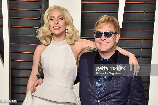 Recording artists Lady Gaga and Elton John attend the 2016 Vanity Fair Oscar Party Hosted By Graydon Carter at the Wallis Annenberg Center for the...