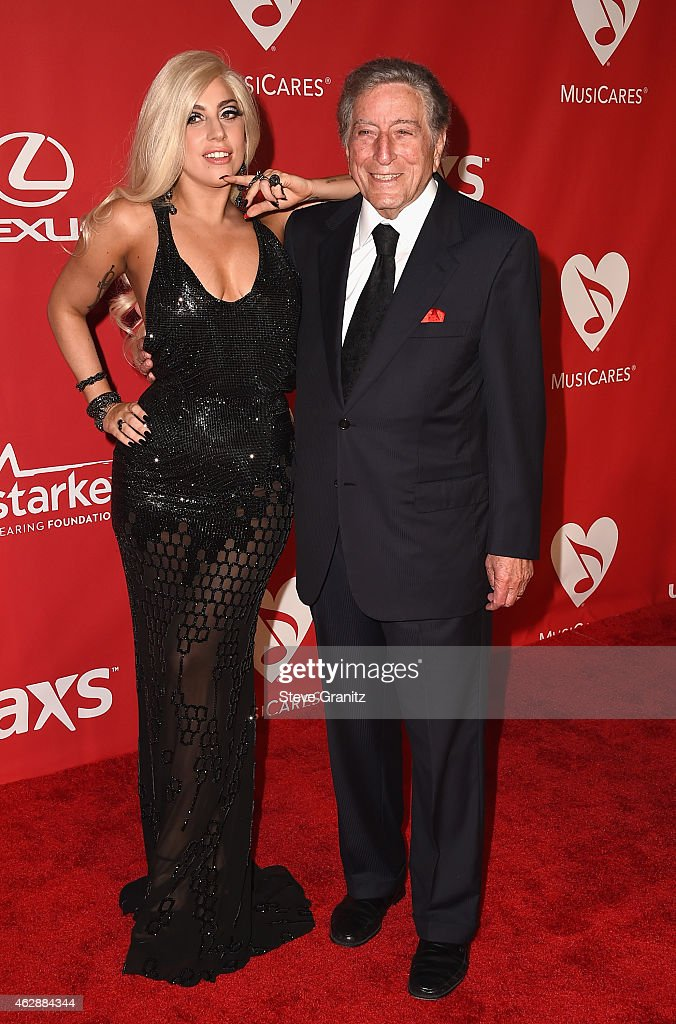 Recording artists Lady Gaga (L) and Tony Bennett attend the 25th anniversary MusiCares 2015 Person Of The Year Gala honoring Bob Dylan at the Los Angeles Convention Center on February 6, 2015 in Los Angeles, California. The annual benefit raises critical funds for MusiCares' Emergency Financial Assistance and Addiction Recovery programs. For more information visit musicares.org.