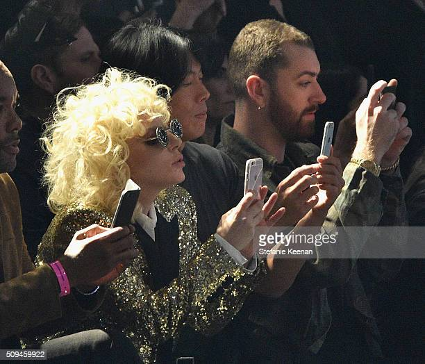 Recording artists Lady Gaga in Saint Laurent by Hedi Slimane and Sam Smith attend Saint Laurent at the Palladium on February 10 2016 in Los Angeles...