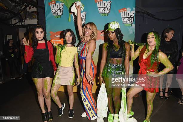 Recording artists Lauren Jauregui Camila Cabello DinahJane Hansen Normani Hamilton and Ally Brooke of music group Fifth Harmony pose backstage after...