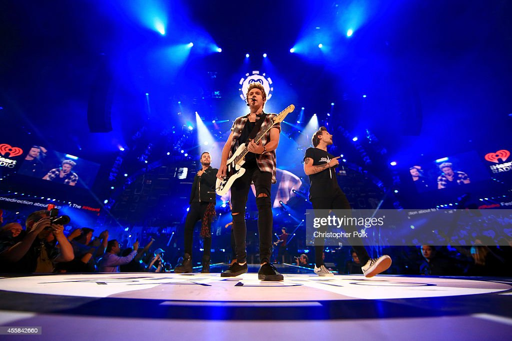 Recording artists Liam Payne, Niall Horan and Louis Tomlinson of music group One Direction performs onstage during the 2014 iHeartRadio Music Festival at the MGM Grand Garden Arena on September 20, 2014 in Las Vegas, Nevada.