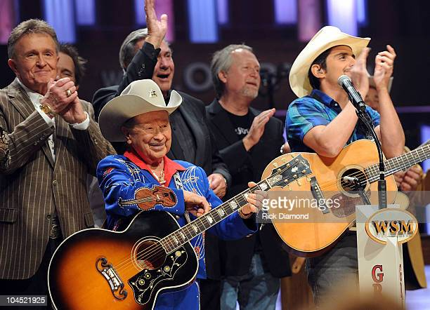Recording Artists Little Jimmy Dickens and Brad Paisley are joined on stage by more than 50 Country music entertainers during Country Comes Home: An...