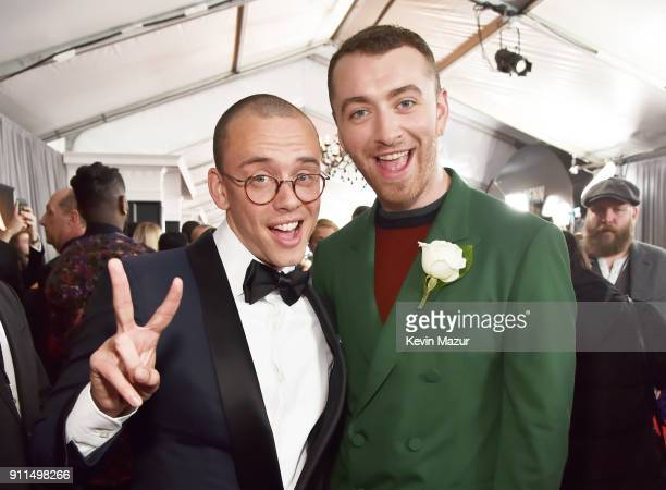 Recording artists Logic and Sam Smith white rose detail attend the 60th Annual GRAMMY Awards at Madison Square Garden on January 28 2018 in New York...