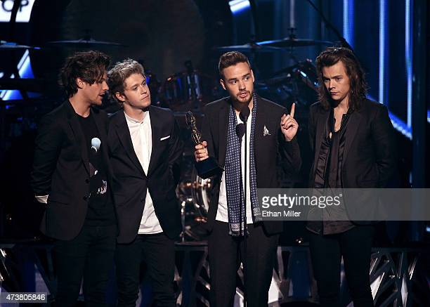 Recording artists Louis Tomlinson Niall Horan Liam Payne and Harry Styles of One Direction accept the Top Duo/Group award onstage during the 2015...