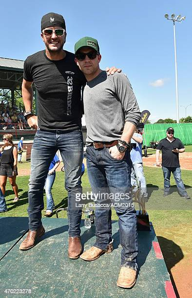 Recording artists Luke Bryan and Justin Moore pose at the ACM Cabela's Great Outdoor Archery Event during the 50th Academy of Country Music Awards at...
