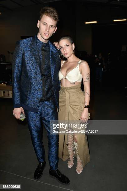 Recording artists Machine Gun Kelly and Halsey attend the 2017 Billboard Music Awards at TMobile Arena on May 21 2017 in Las Vegas Nevada