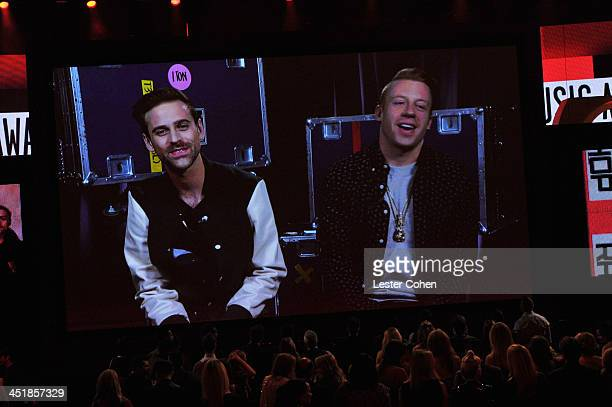 Recording artists Macklemore and Ryan Lewis accept the award for Favorite Album - Rap/Hip-Hop for 'The Heist' onscreen during the 2013 American Music...