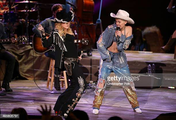 Recording artists Madonna and Miley Cyrus perform onstage during Miley Cyrus MTV Unplugged at Sunset Gower Studios on January 28 2014 in Hollywood...