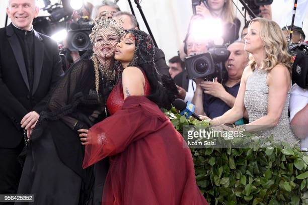 Recording artists Madonna and Nicki Minaj attend the Heavenly Bodies Fashion The Catholic Imagination Costume Institute Gala at The Metropolitan...