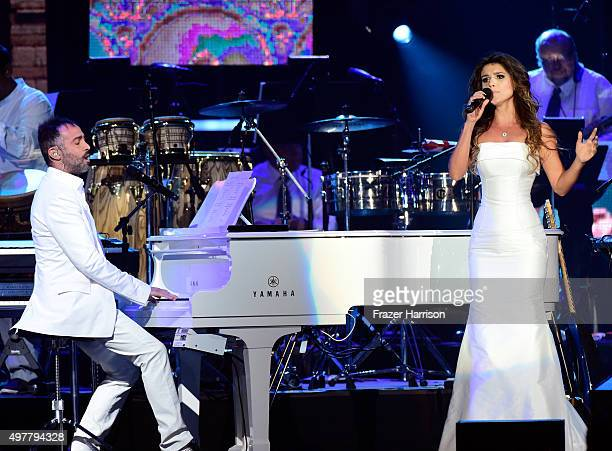 Recording artists Mario Domm of Camila and Paula Fernandes perform onstage during the 2015 Latin GRAMMY Person of the Year honoring Roberto Carlos at...